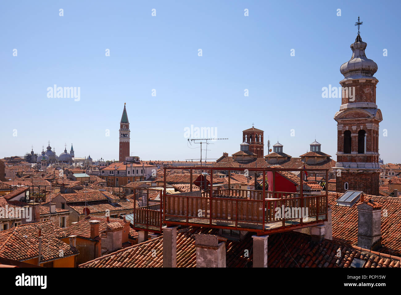 Venice roofs with typical altana balcony and San Marco bell tower in summer, Italy - Stock Image