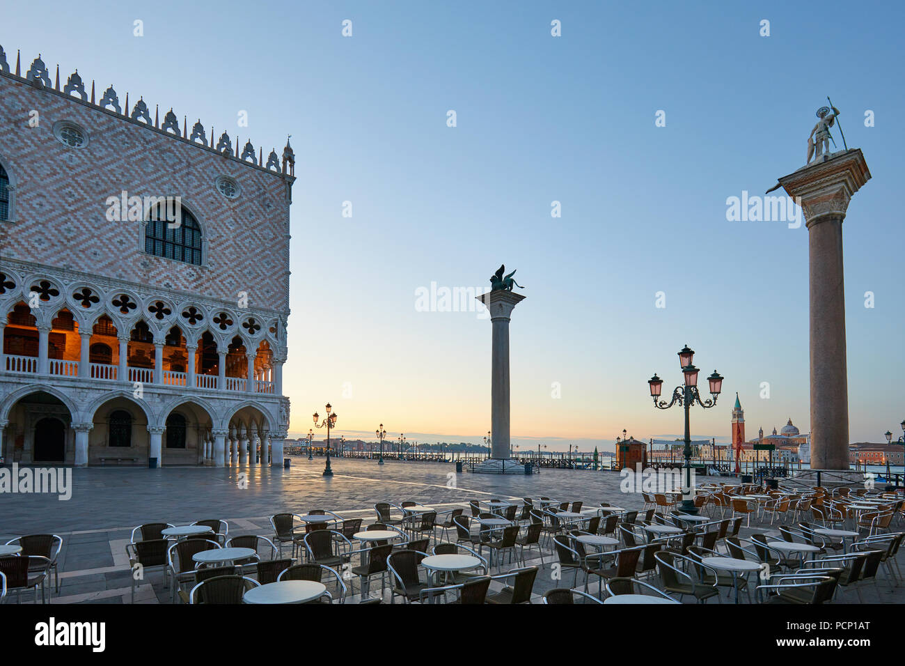 San Marco square with empty sidewalk tables, nobody at sunrise in Venice, Italy - Stock Image
