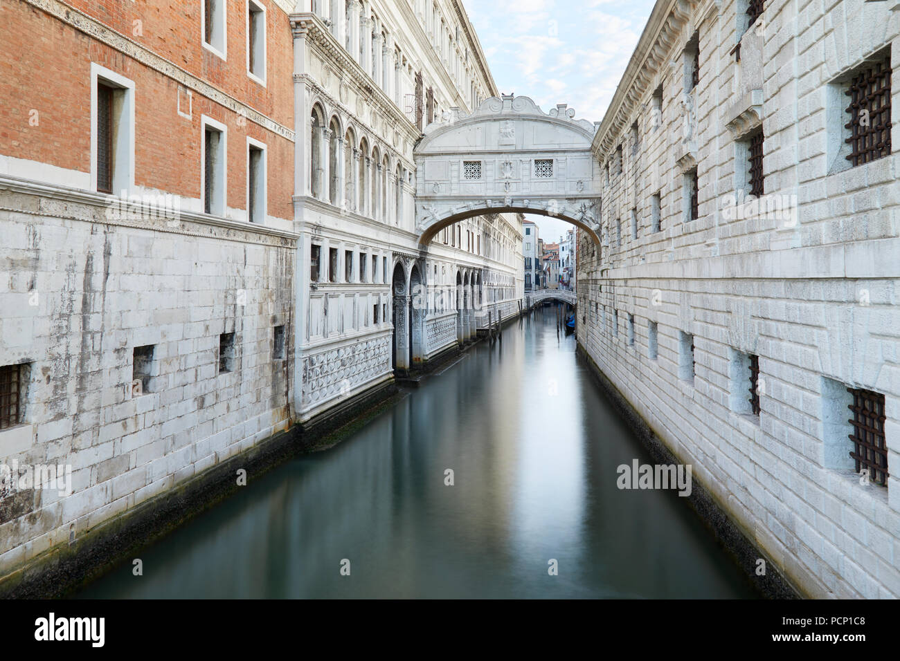 Bridge of Sighs and calm water in the canal, nobody in Venice, Italy - Stock Image