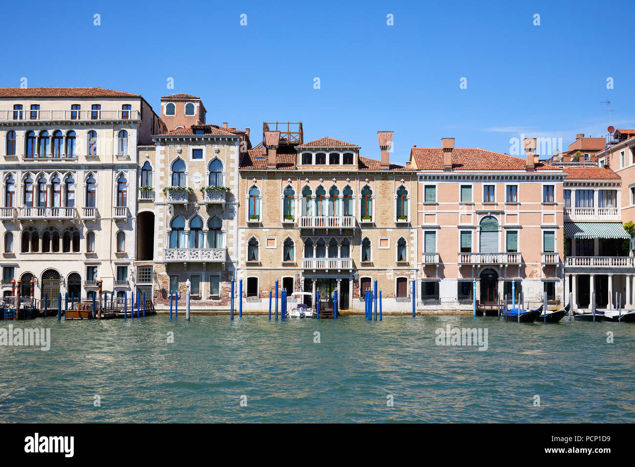 Venice ancient buildings facades and the grand canal in a sunny day in Italy - Stock Image