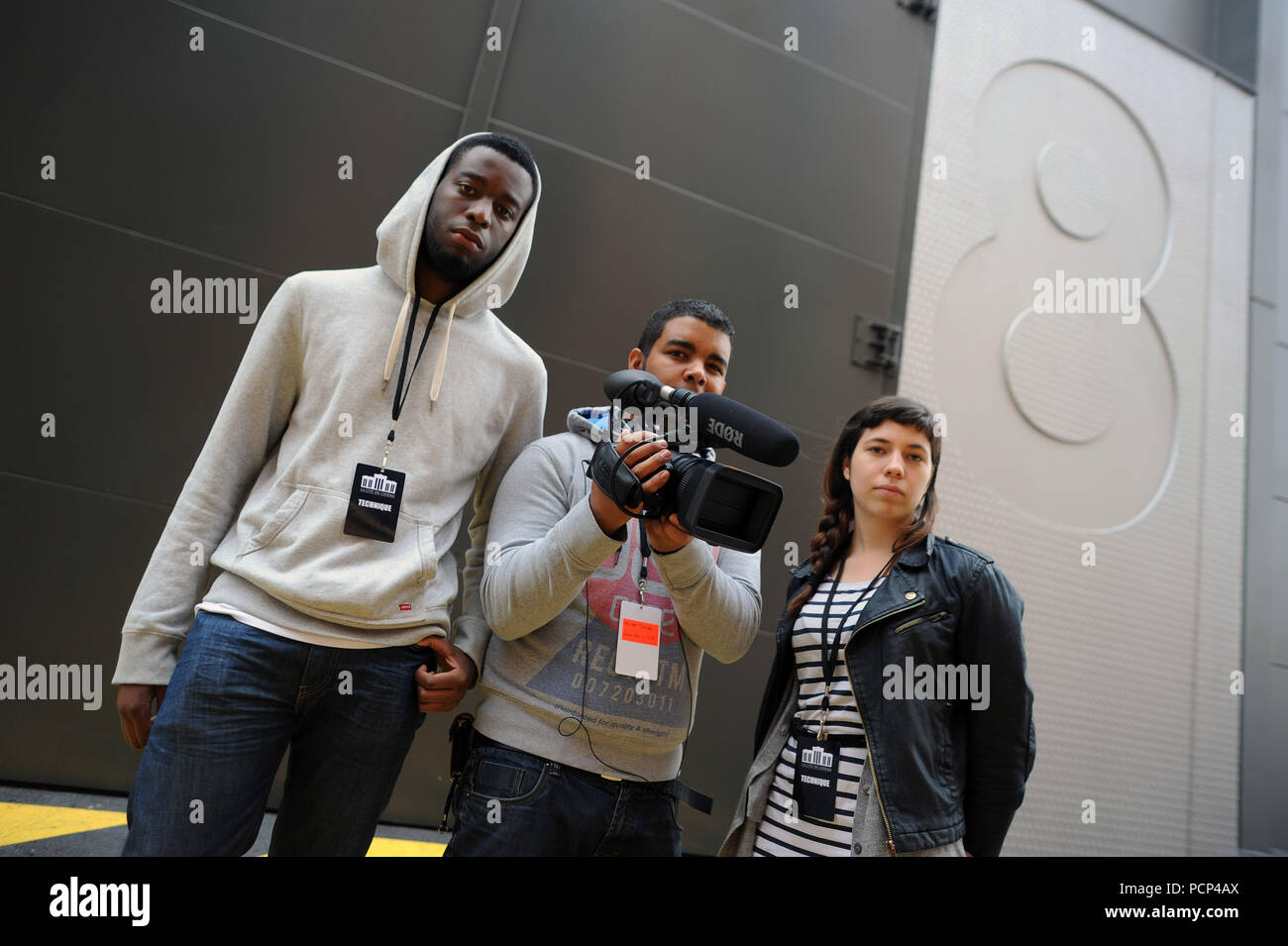 September 21, 2012 - Saint-Denis, France: Students from Luc Besson's cinema school attend the opening of the 'cinema city' (Cite du Cinema) on the edge of Paris. The 170-million-euros project is the largest film studio facility ever built in France, which earned it the nickname 'Hollywood on Seine'. The former art deco power station compound houses nine state-of-the-art film sets, 20,000sq metres of office, and several carpentry, model-making, and costume workshops. Des etudiants en cinema de l'Žcole de Luc Besson assistent a l'inauguration de la Cite du cinema. *** FRANCE OUT / NO SALES TO FR - Stock Image