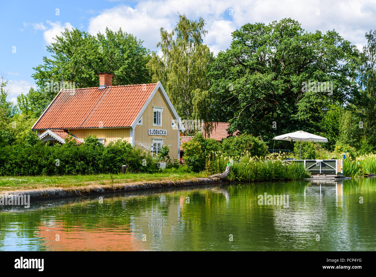 Sjobacka, Sweden - June 30, 2018: An ordinary day along the Gota canal. Here the house where the Sjobacka bridge guard lived in the old days. - Stock Image