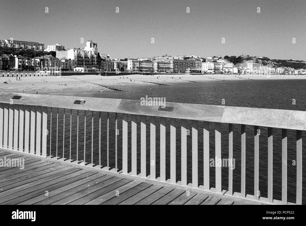 Hastings seafront from Hastings Pier in summer, East Sussex UK, looking East towards the town centre - Stock Image