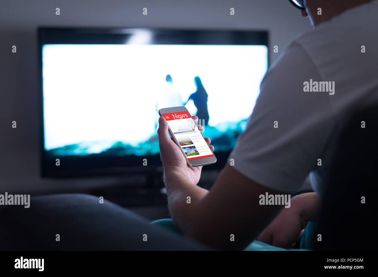 cc52321da1c5ba Man reading online news on smartphone at home. Mobile phone news website,  application or portal on cellphone screen. Holding smart device in hand.