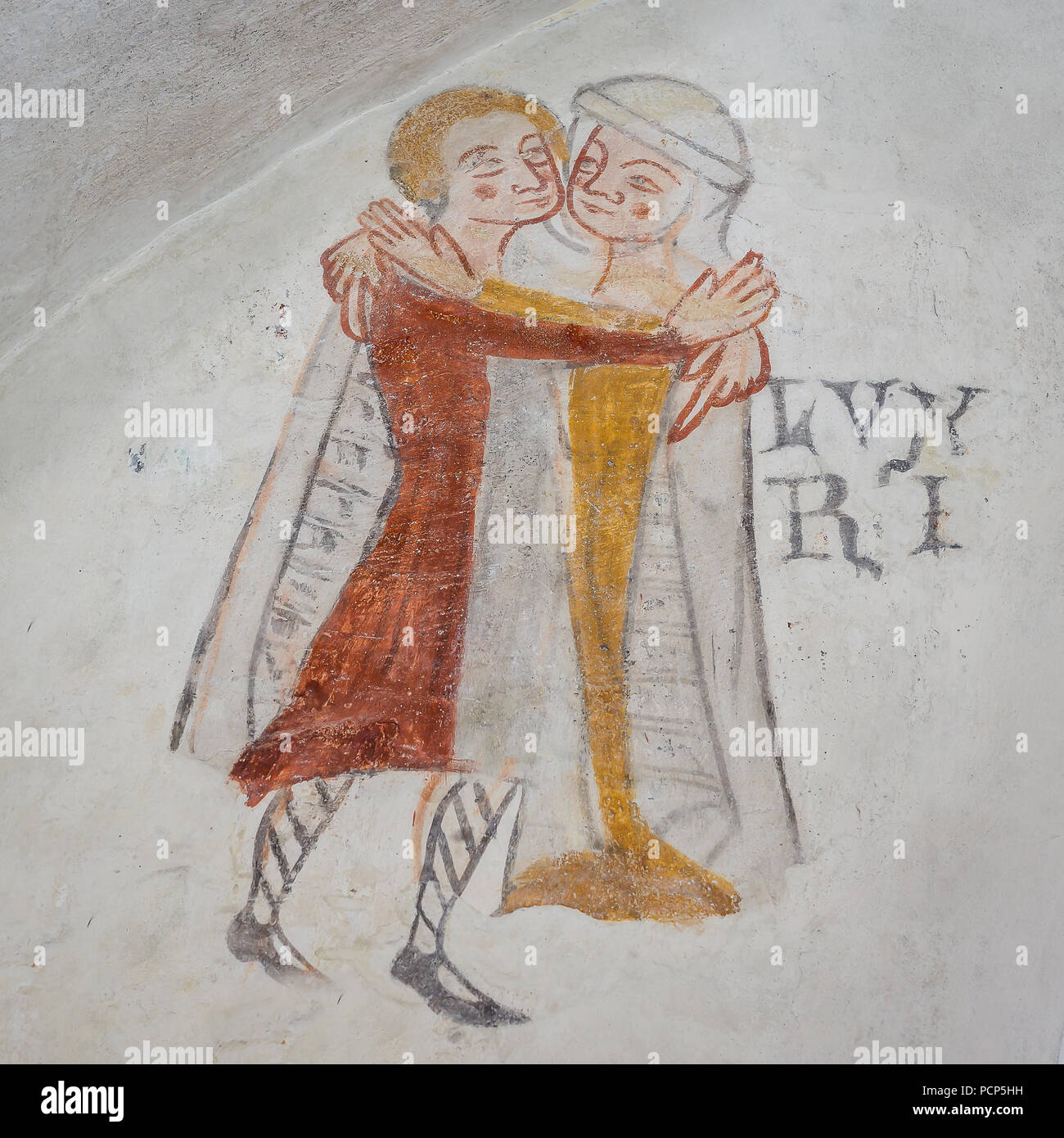 Lust, one of the mortal sins. Man and woman embracing, an ancient gothic mural in Kirkerup public church, Denmark, July 3, 2018, - Stock Image