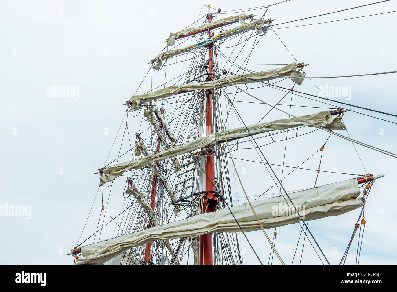 The rigging of a square rigger, the brig Aphrodite, foreamast and mainmast with rotated yards against the blue sky, Hundested, Denmark, July 31, 2018 - Stock Image