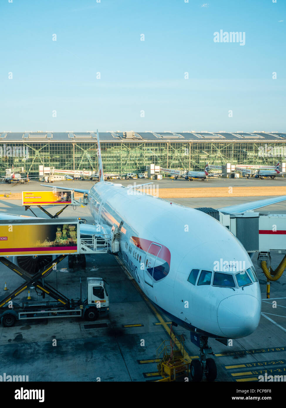 Plane being Serviced, Heathrow Airport, London, UK, GB. - Stock Image