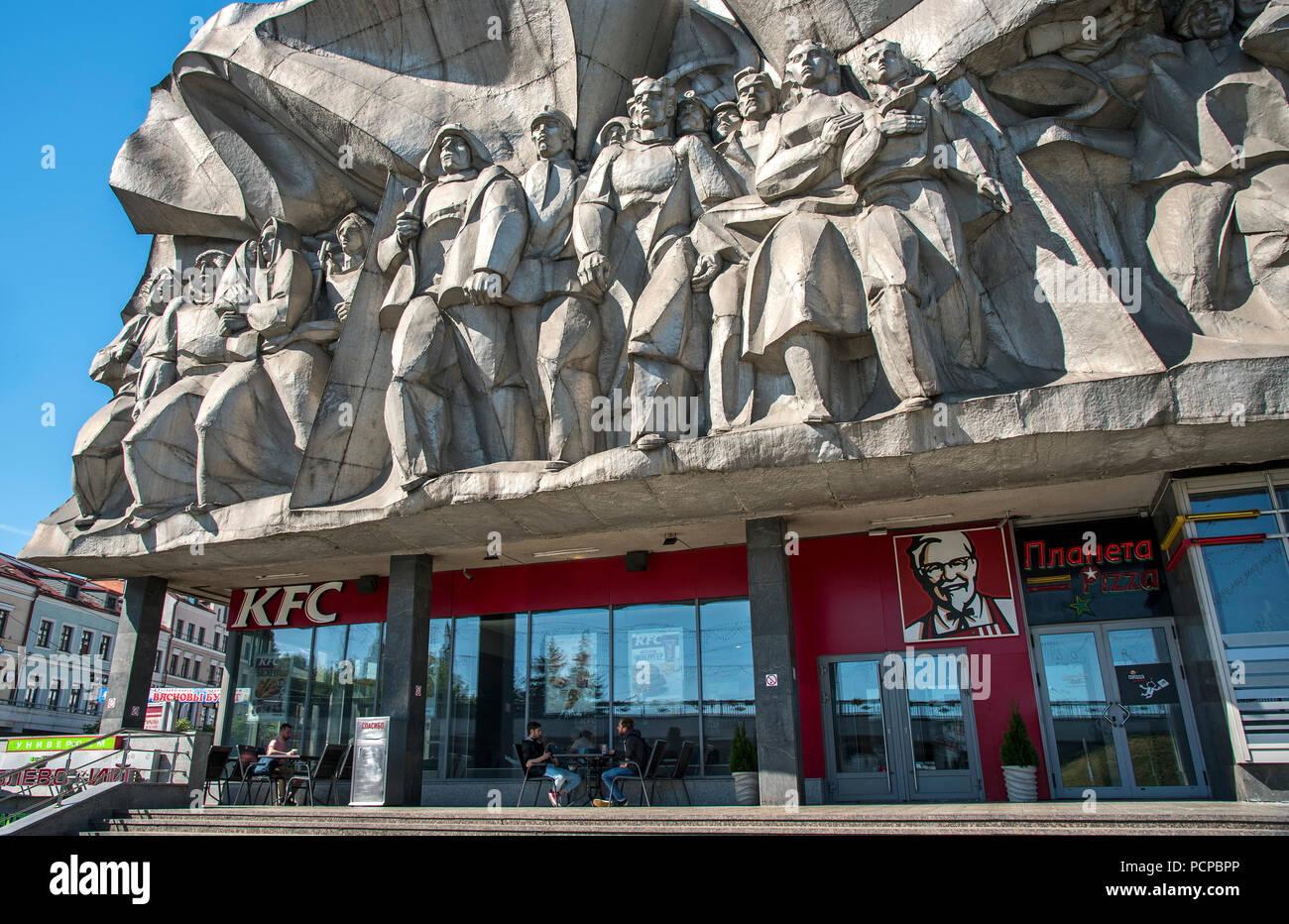 KFC with Soviet Socialist Realism sculpture above. Minsk, Belarus - Stock Image