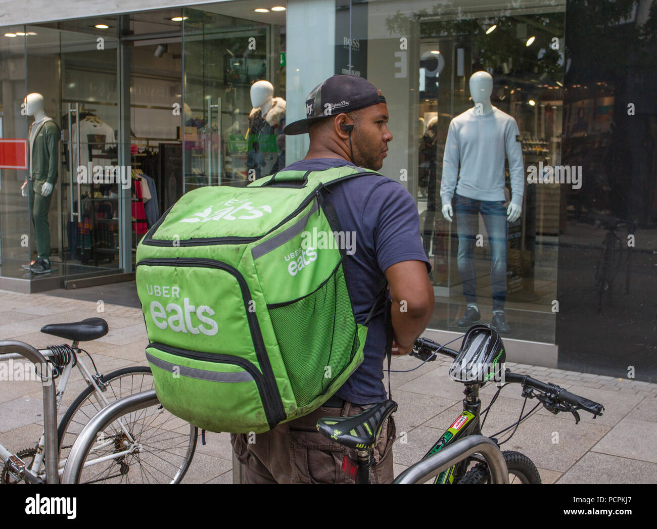 Uber Eats, an American online food ordering and delivery; cyclist in Fishergate, Preston, Lancashie, UK Stock Photo