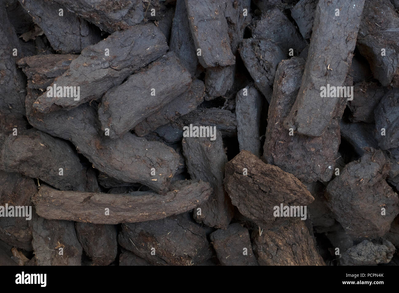 Pile of old fashioned dried peat blocks full frame closeup - Stock Image