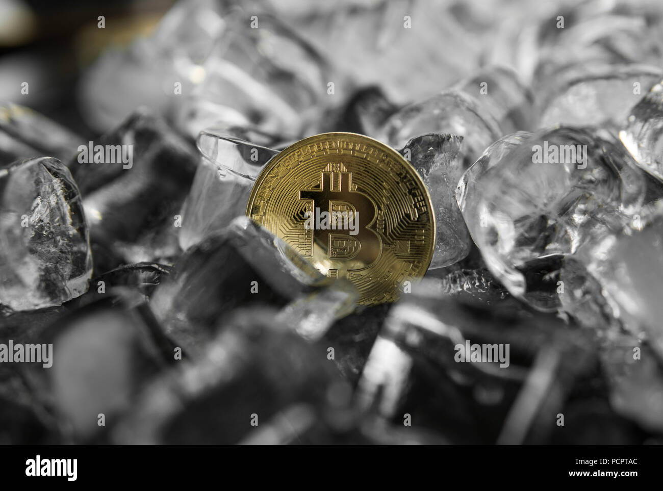 Gold bitcoin on ice background. The concept of the exchange in winter. Freeze. Blockchain mining. Digital money and virtual cryptocurrency concept. Iinvestment. Bussiness, commercial - Stock Image