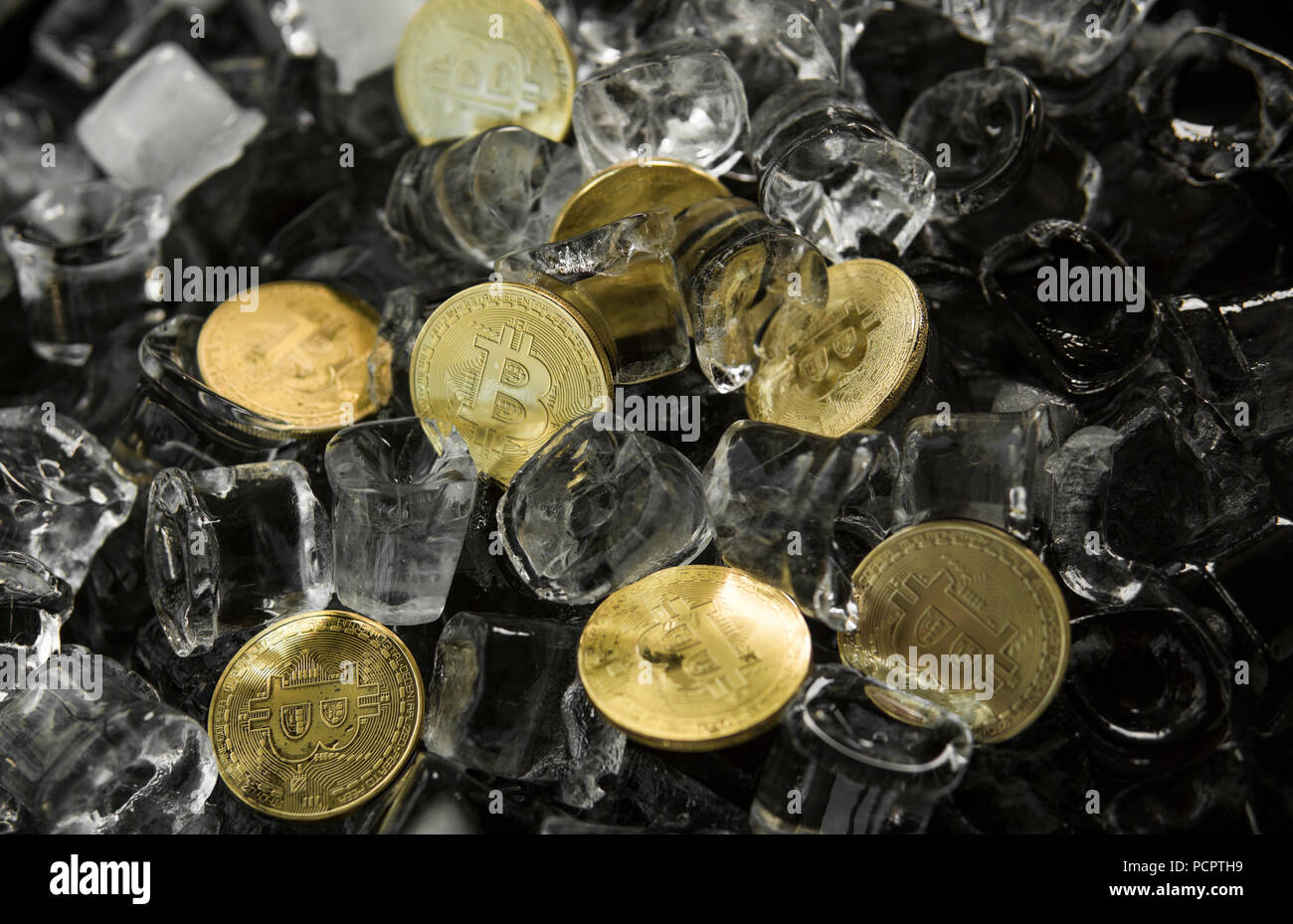 Many gold bitcoin coins on ice background. Freeze. Blockchain mining. Digital money and virtual cryptocurrency concept. Iinvestment. Bussiness, commercial - Stock Image
