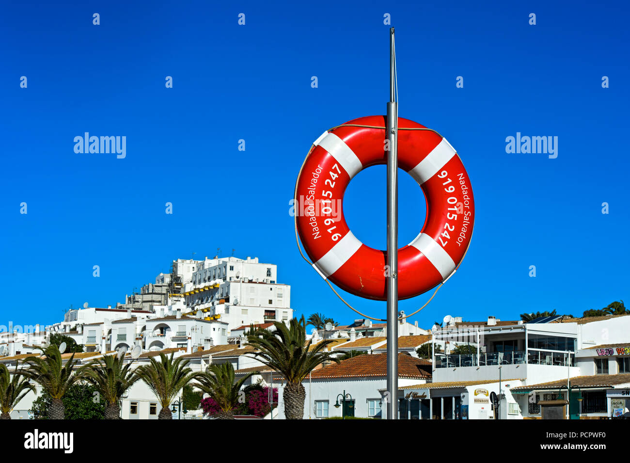 Rescue buoy at the beach, Praia da Luz, Luz, Algarve, Portugal - Stock Image