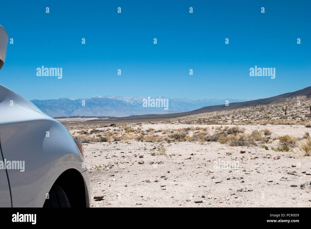 Car in the desert. Concept of adventure, road trip. Concept of test drive. Extreme environment. Hot weather. 120 degree. - Stock Image