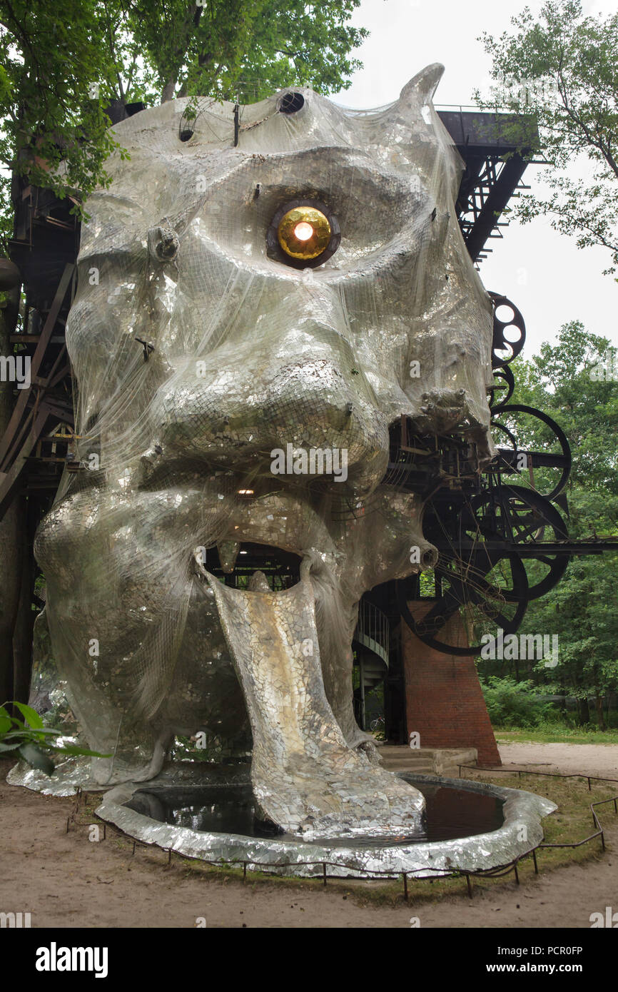 Monumental kinetic sculpture Le Cyclop designed by Swiss sculptor Jean Tinguely in cooperation with French sculptor Niki de Saint Phalle from 1969 to 1994 in the forest next to the village of Milly-la-Forêt in Essonne, Île-de-France Region, France. - Stock Image