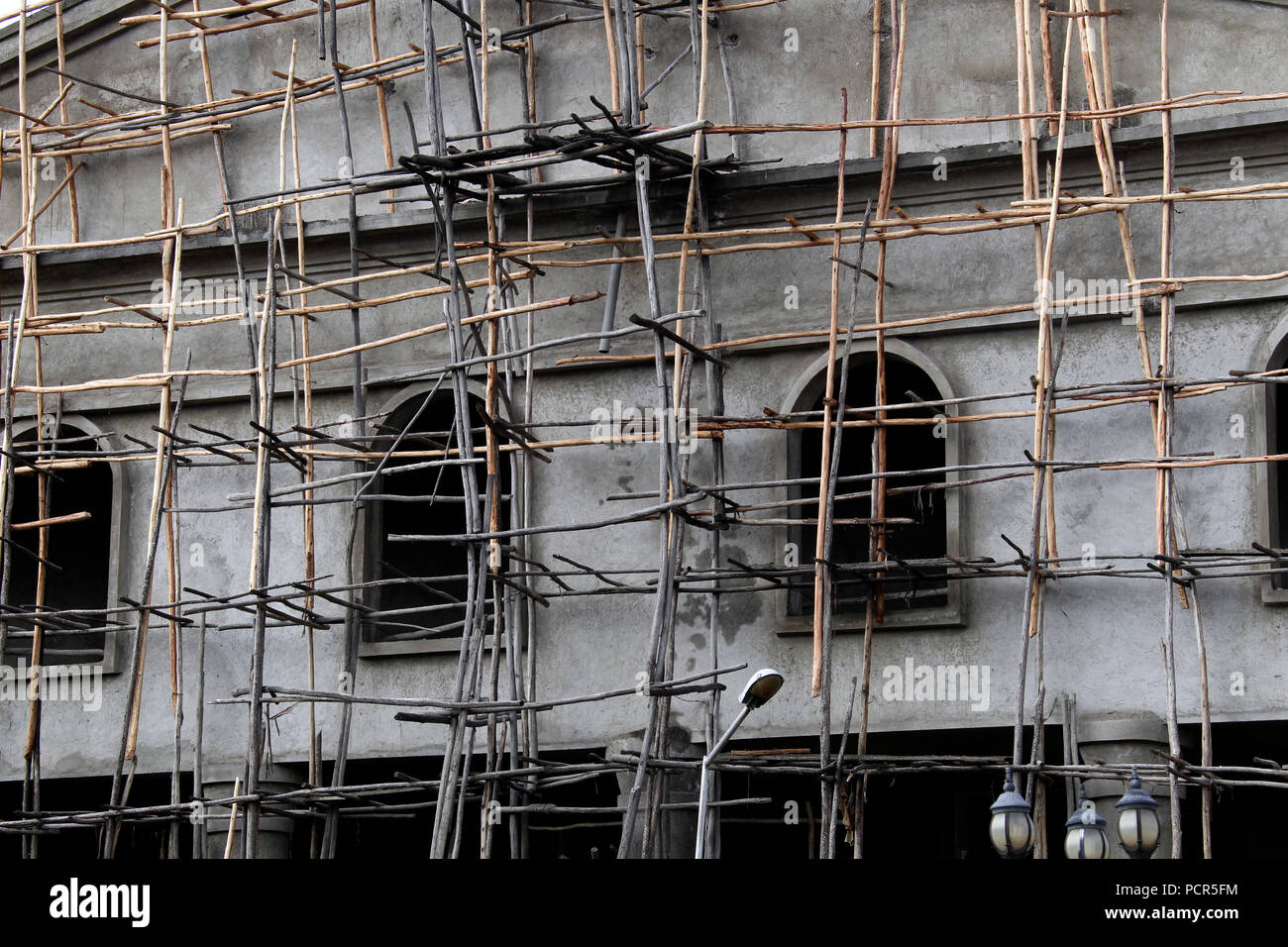 Wooden scaffolding on house wall, construction work, Addis Ababa, Ethiopia - Stock Image