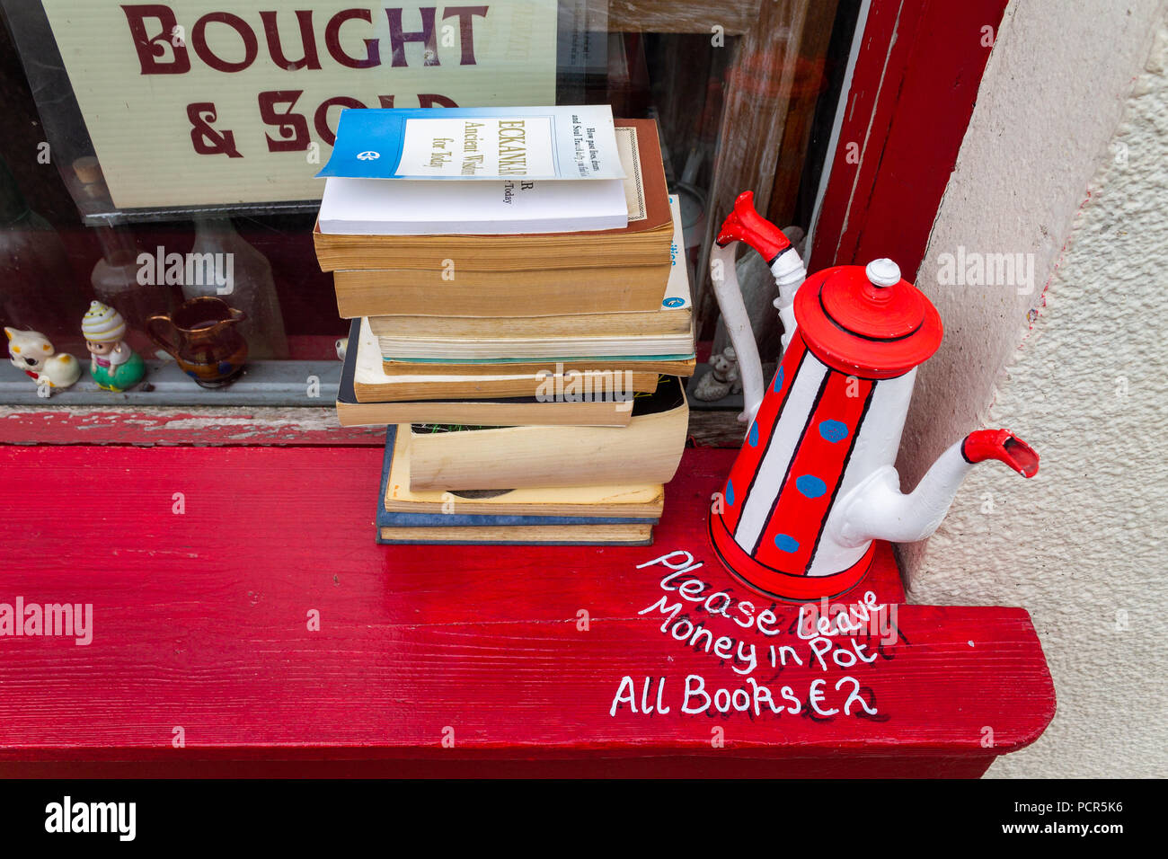 second hand softback books for sale on a window ledge. - Stock Image