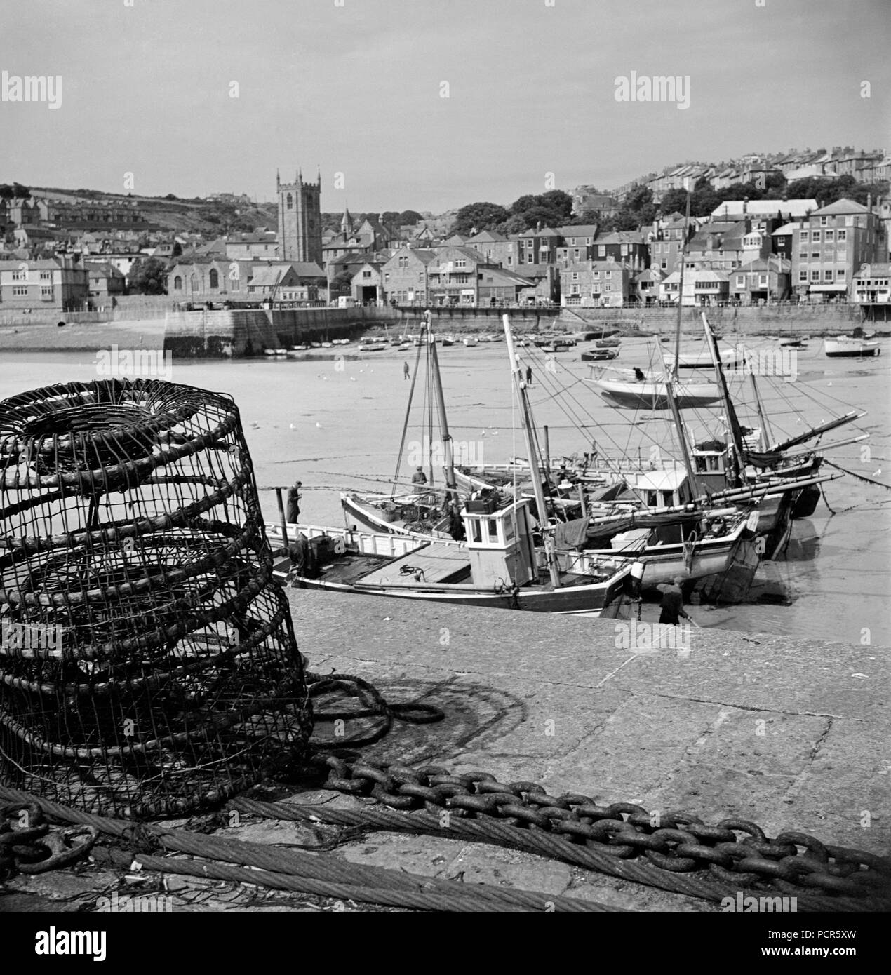 St Ives, Cornwall, 1950. A view looking across the harbour to the town from Smeaton's Pier, taken during the photographer's holiday to Cornwall. - Stock Image