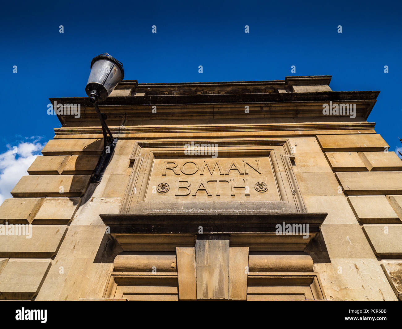 Roman Bath - Sign outside the Roman Baths in the City of Bath, Somerset, UK - Stock Image