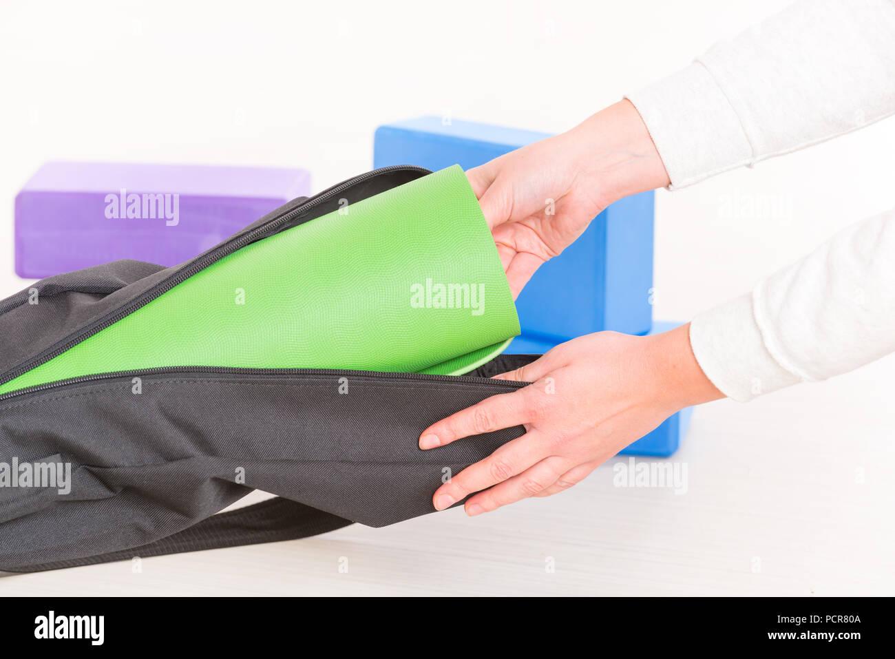 Putting a yoga mat inside a special yoga bag Stock Photo  214411466 ... 31406171a8155