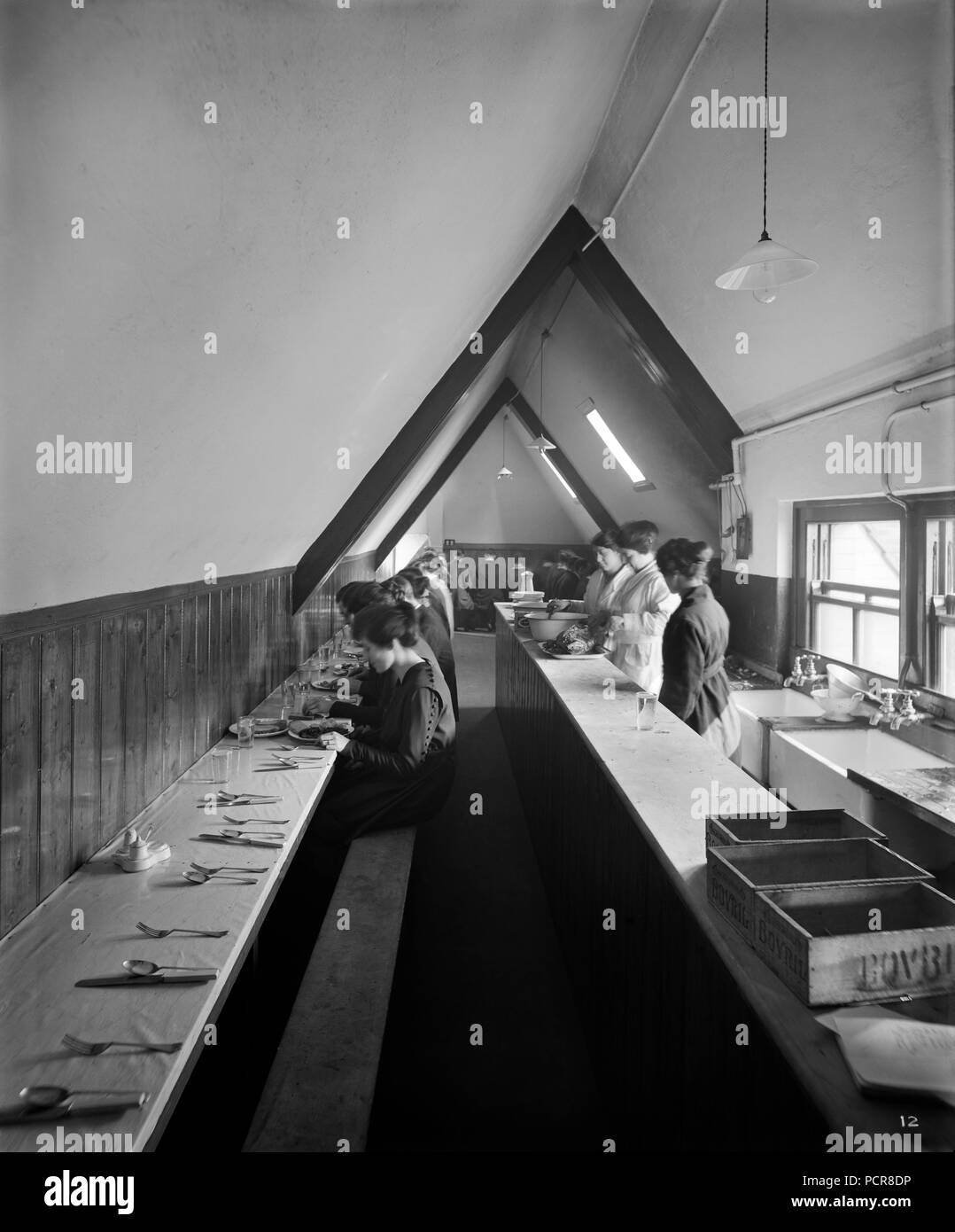 Workers' cafeteria, 41 Kingsway, Westminster, London, 1920. An interior view showing workers dining in the canteen above 'Pen Corner', a large shop owned by LG Sloan Limited, selling and repairing Waterman's and other fine pens. LG Sloan Limited also supplied various accessories related to pens and correspondence. - Stock Image