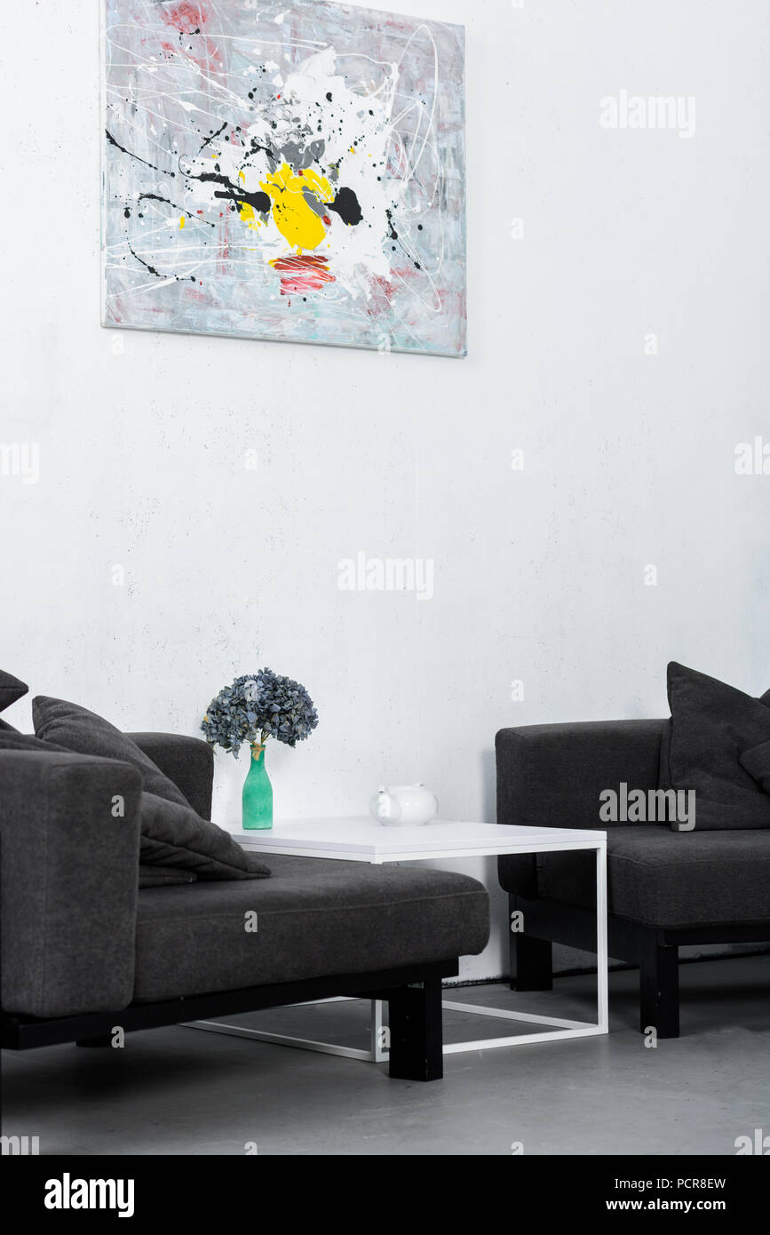 paint on wall, black modern armchairs in living room Stock ...