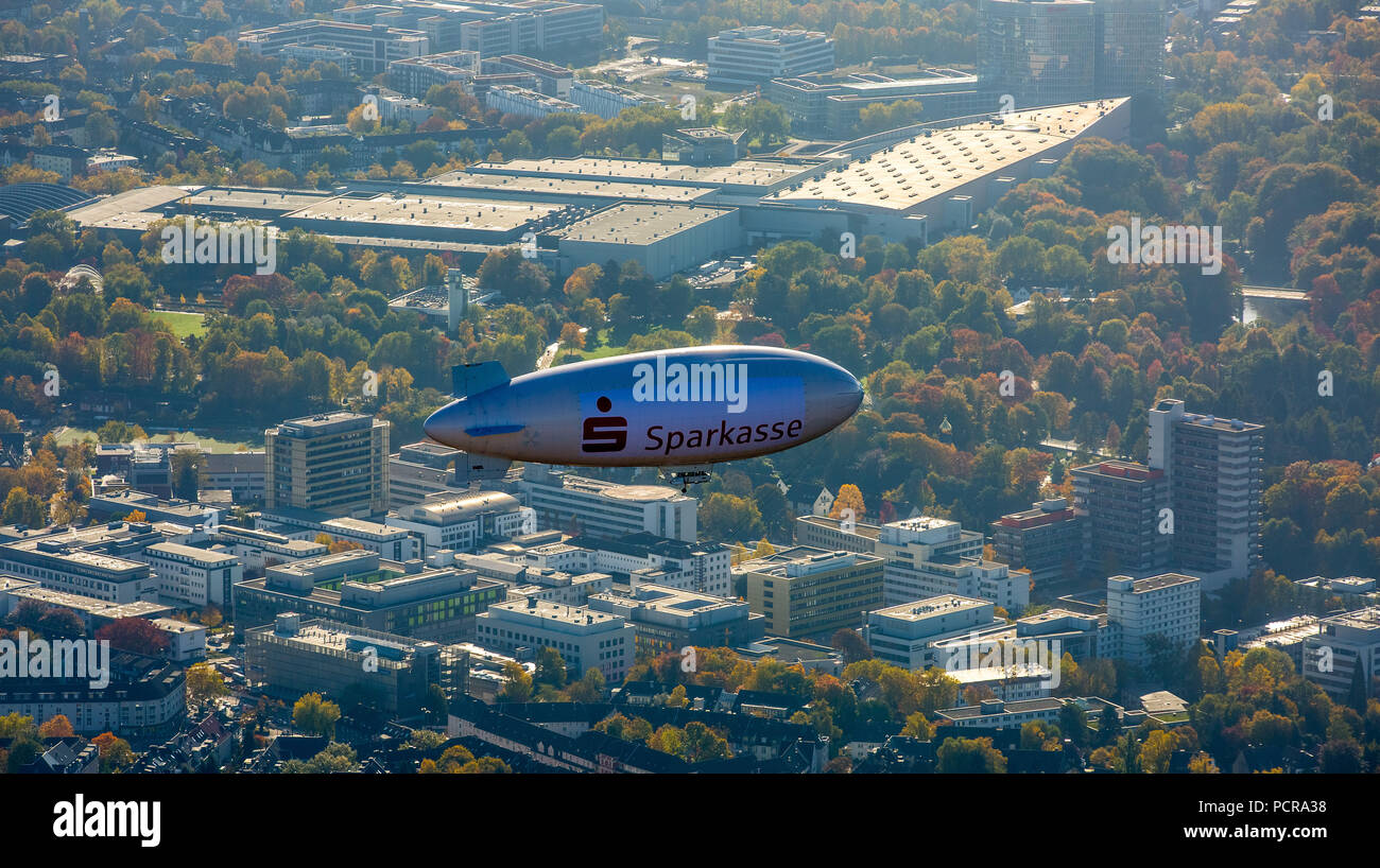 One of the first sightseeing flights of the Sparkassen Blimp, Zeppelin over Essen in the Rüttenscheid area at the Essen hospital, Essen, Ruhr area, North Rhine-Westphalia, Germany - Stock Image