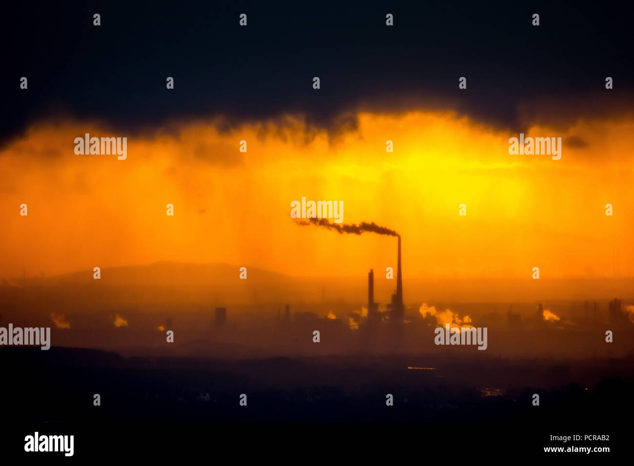 Chemical Park Marl in the back light after a rain shower, evening sun, industrial backdrop, silhouette of the chemical industry, sunset, Marl, Ruhr area, North Rhine-Westphalia, Germany - Stock Image
