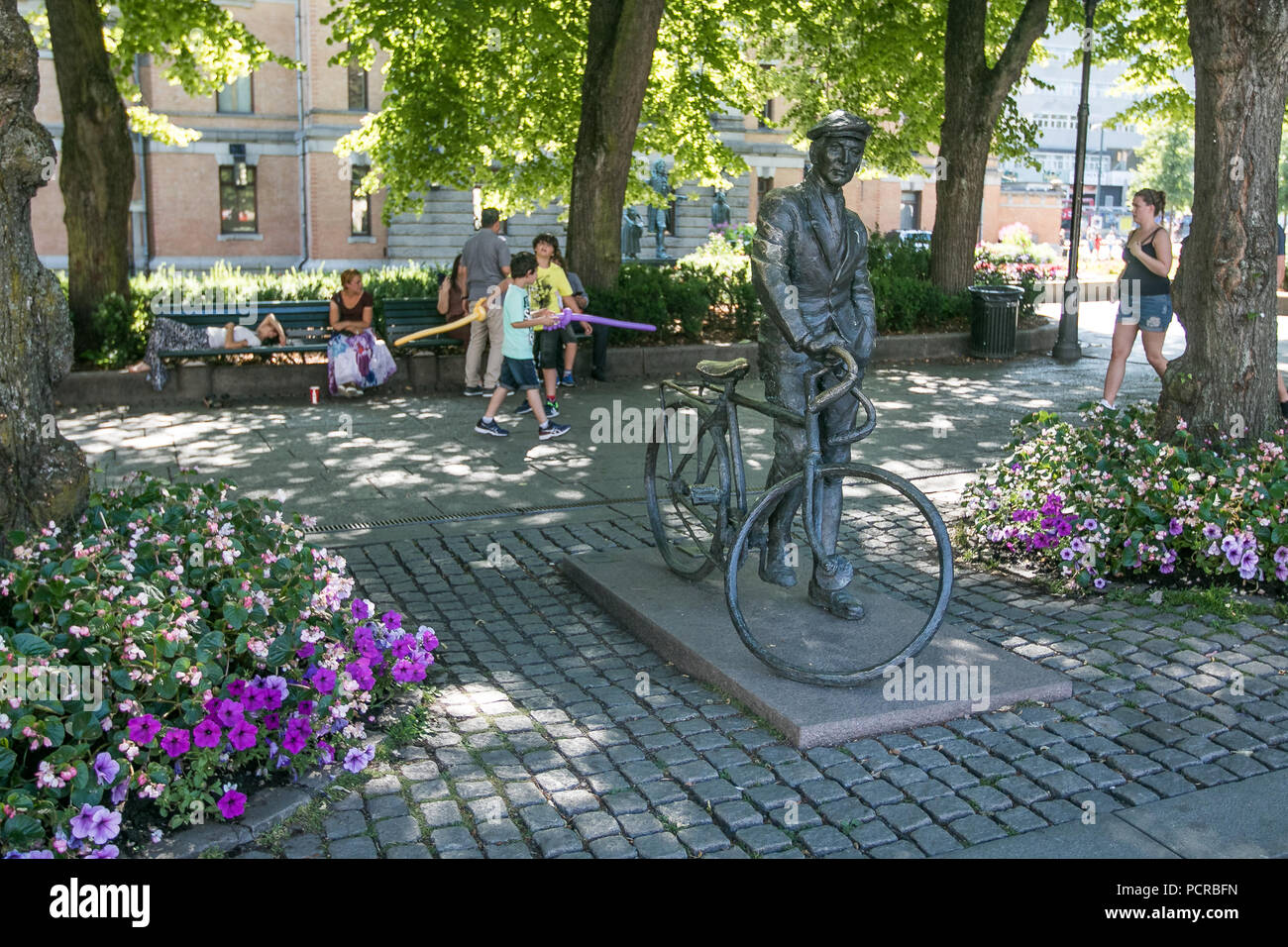 Oslo, Norway, July 21, 2018: 'Man with a bike' - a statue by Norwegian artist Per Ung near National Theater. - Stock Image