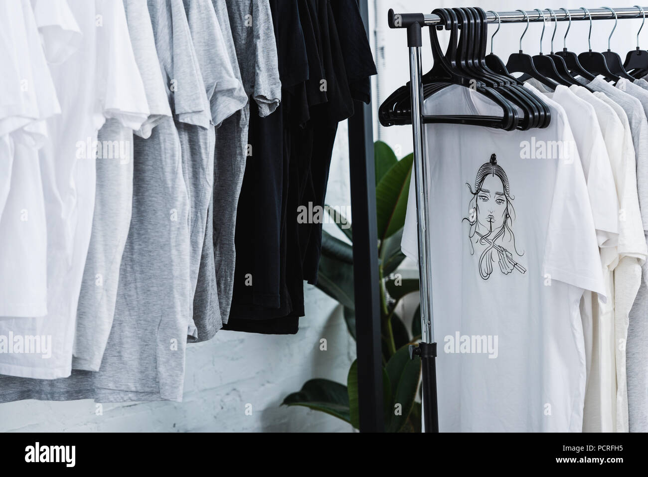Selective Focus Of T Shirts With Print On Hangers In Clothing Design