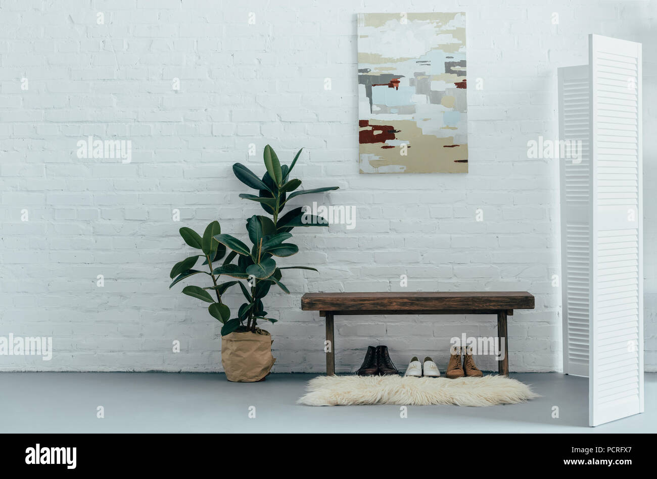 interior of light modern corridor with folding screen in apartment Stock Photo