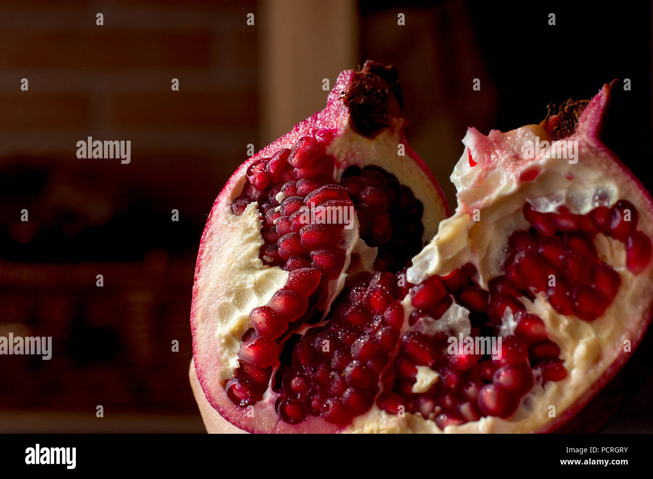 Large red juicy pomegranate. Free space for text. - Stock Image