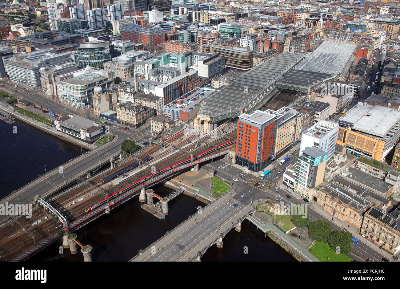 Newcastle Station and the River Tyne from the air as GBRF 66702 heads a coal train for Tyne Dock on 4.9.12. - Stock Image