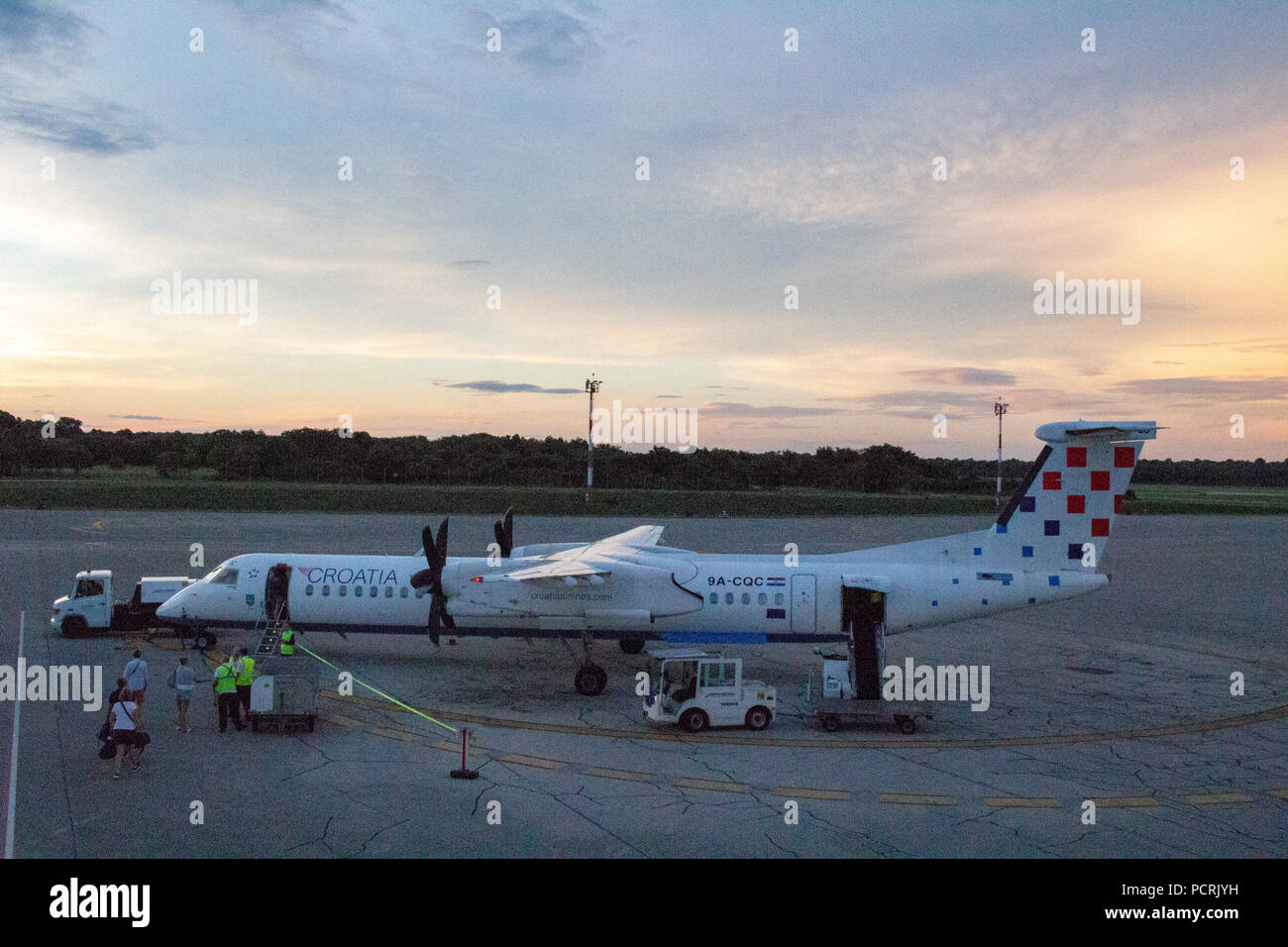 Pula, Croatia - July 23, 2018: roatia Airlines Bombardier Dash Q400 9A-CQC parked at Pula Airport - Stock Image