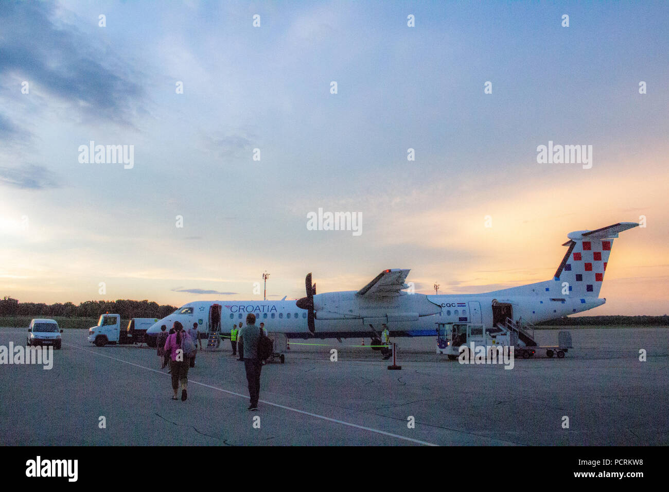 Pula, Croatia - July 23, 2018: Passengers boarding the Croatia Airlines Bombardier Dash Q400 9A-CQC to Zadar - Stock Image