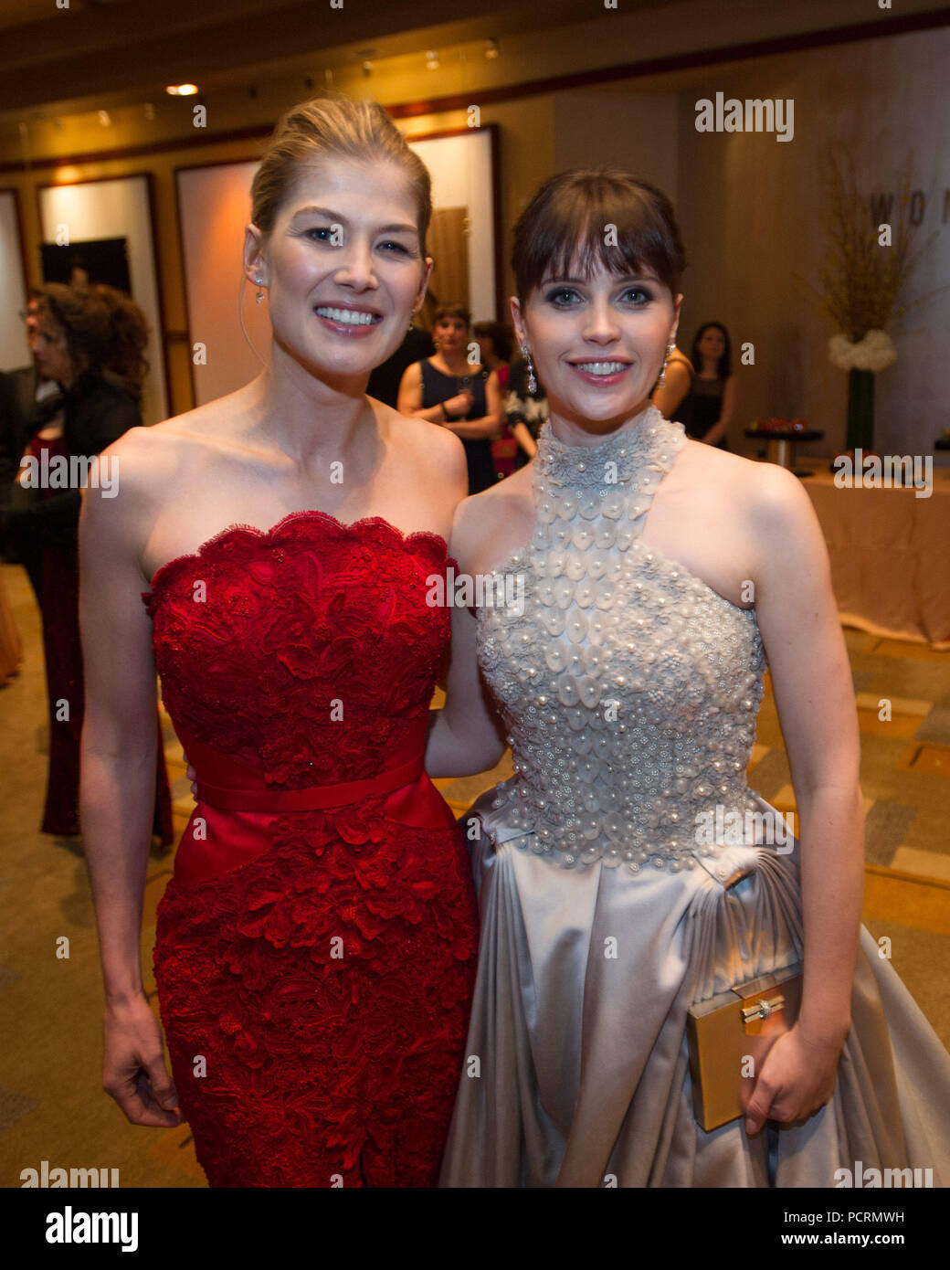 HOLLYWOOD, CA - FEBRUARY 22:  Rosamund Pike and Felicity Jones attendst the 87th Annual Academy Awards at Hollywood & Highland Center on February 22, 2015 in Hollywood, California.   People:  Rosamund Pike and Felicity Jones Stock Photo