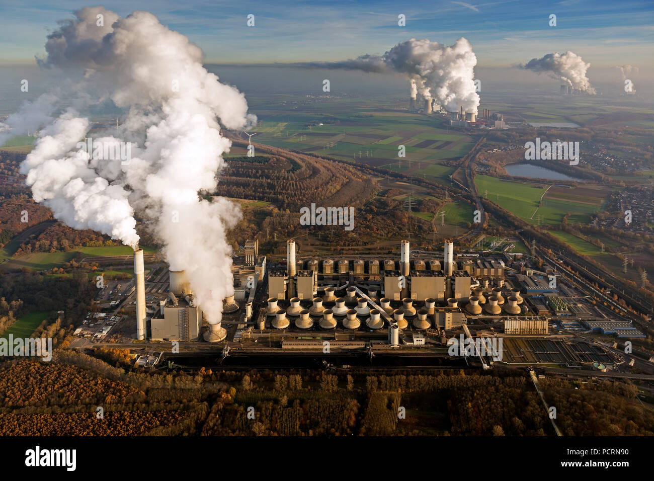 Brown coal power station, smoke, steam, power generation, aerial view of Grevenbroich, Lower Rhine - Stock Image