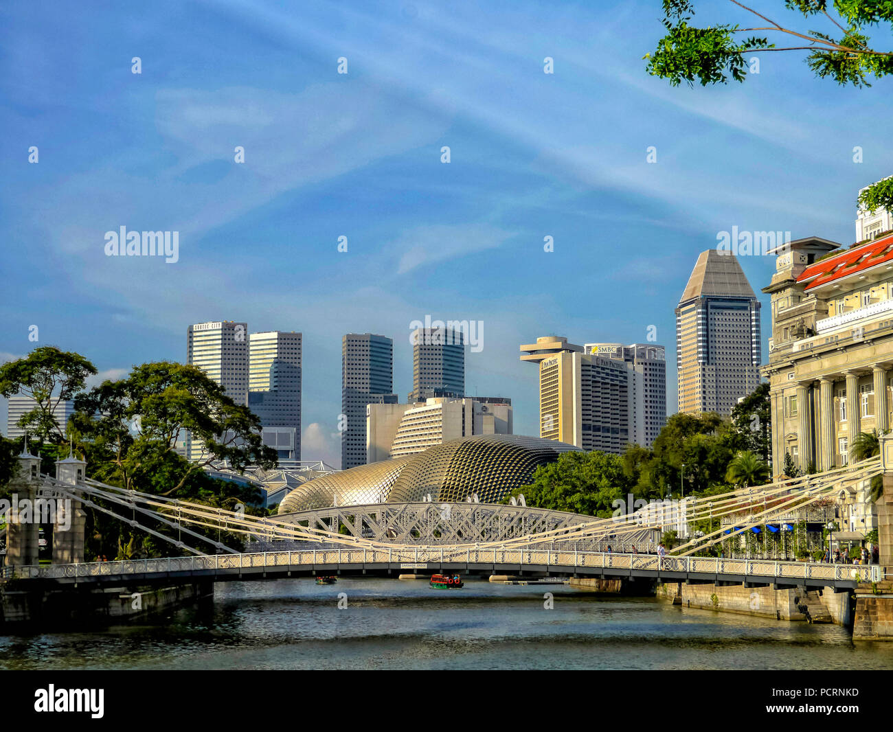 Fullerton Hotel at Singapore River and Financial District Skyscrapers, Central Area, Central Business District, Anderson Bridge, Singapore, Asia, Singapore - Stock Image