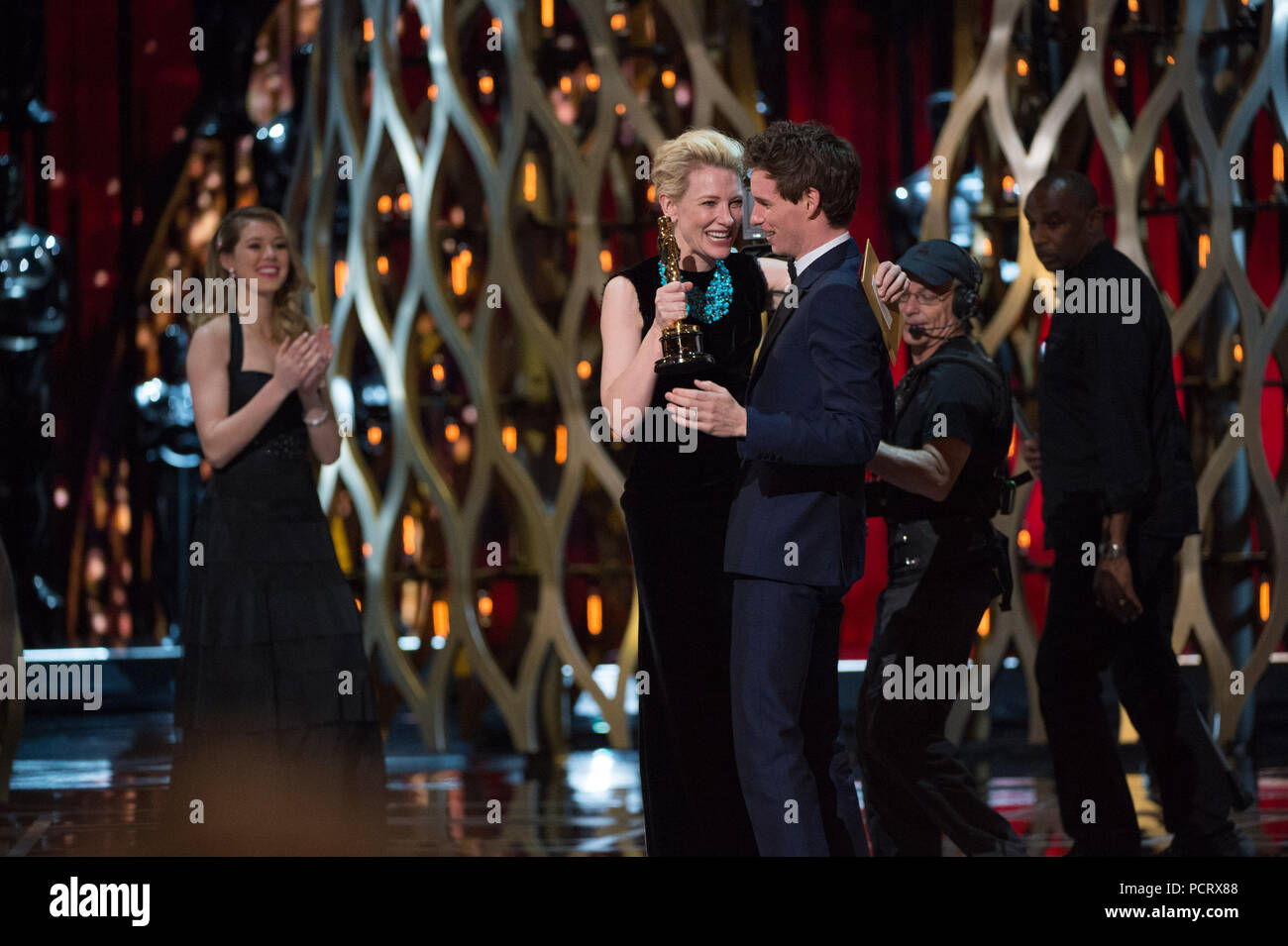 HOLLYWOOD, CA - FEBRUARY 22: Cate Blanchett and Eddie Redmayne onstage during the 87th Annual Academy Awards at Dolby Theatre on February 22, 2015 in Hollywood, California.   People:  Cate Blanchett and Eddie Redmayne - Stock Image