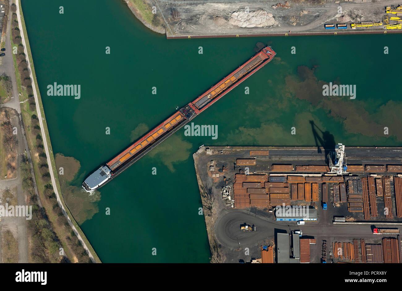 Aerial view, Dortmund harbor, Eisenhafen, Dortmund-Ems canal, push barge, cargo ship, inland shipping, turning maneuver, mud, departing maneuver, barge, Dortmund, Ruhr area, North Rhine-Westphalia, Germany, Europe - Stock Image