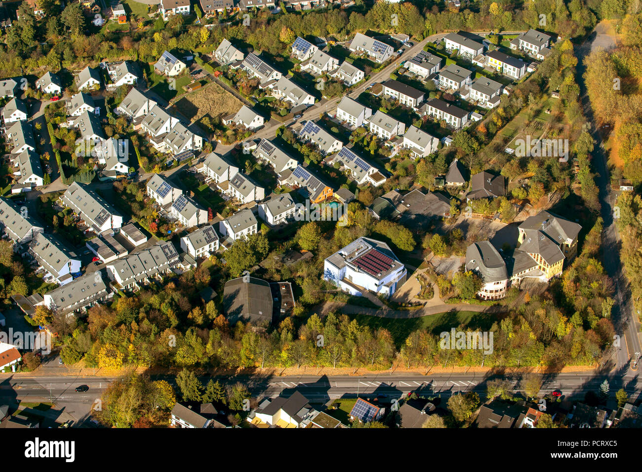 Aerial view, terraced housing, new housing estate Am Stenshof, solar roofs, photovoltaic systems, Waldorf School Hoentrop in autumn, golden october, Bochum, Wattenscheid, Ruhr area, North Rhine-Westphalia, Germany, Europe - Stock Image