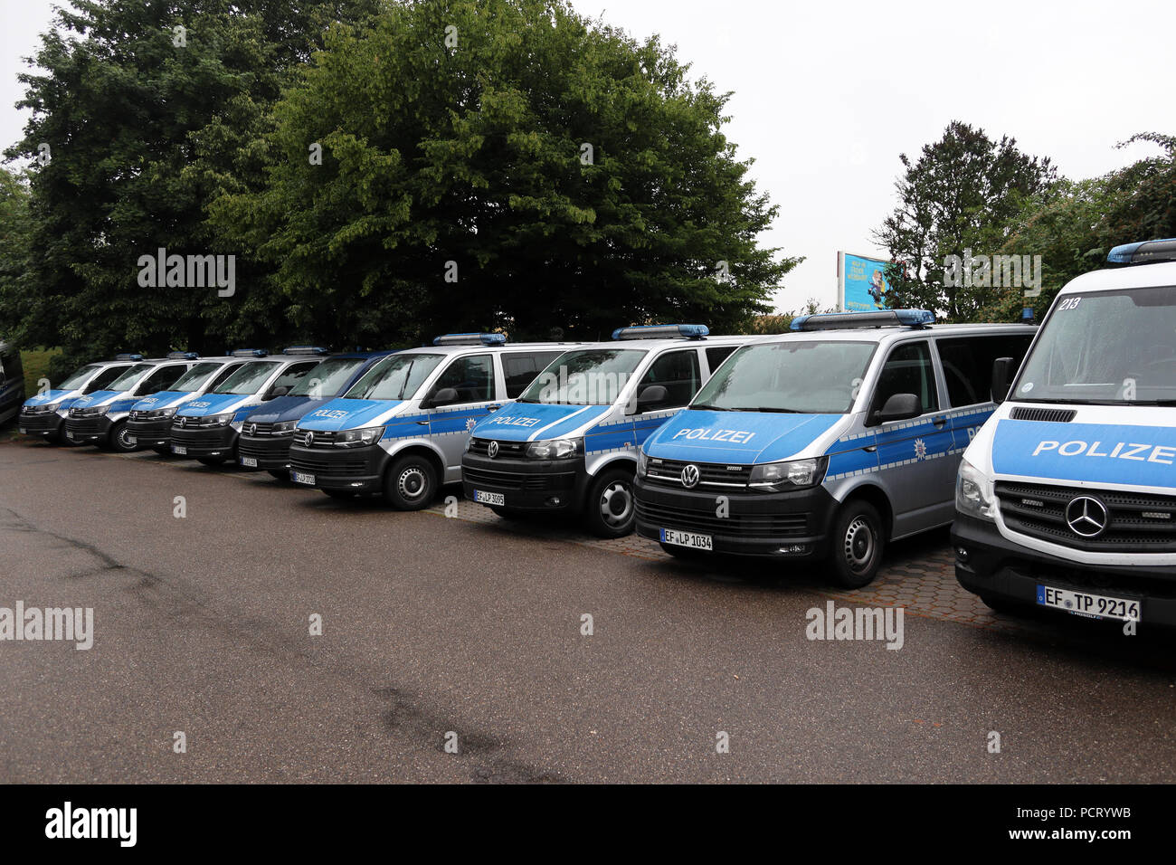 Police vehicles parked near Augsburg, Germany - Stock Image
