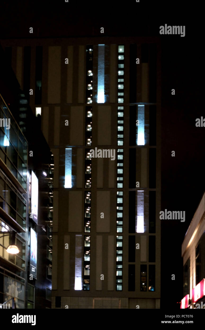The modern lighting of department stores and shops at night in the dark - Stock Image