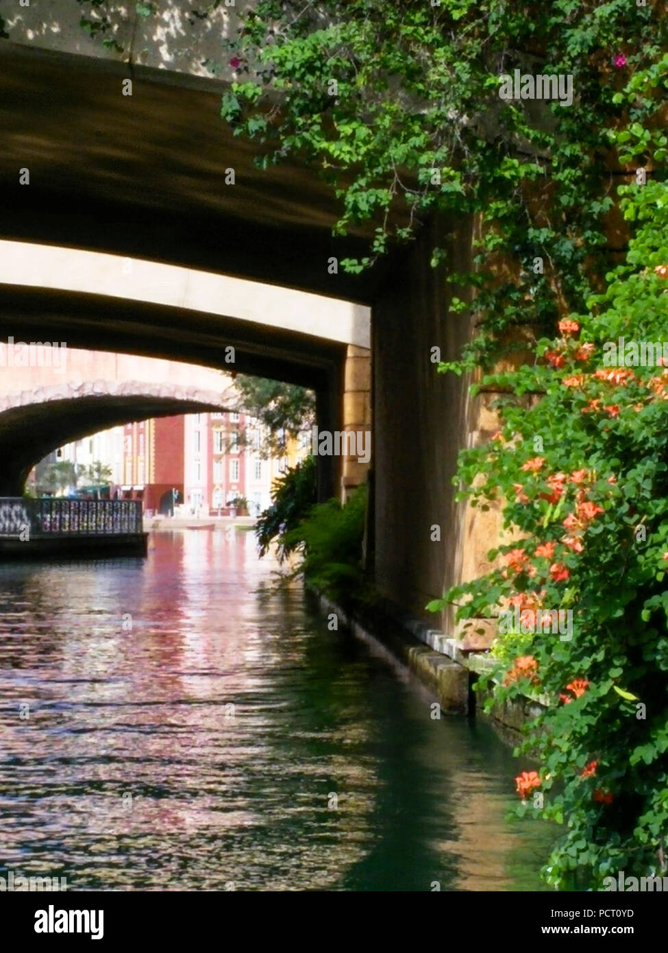 Universal Studios water taxi waterway with two overpasses, on way to theme park. Orlando, Florida, US - Stock Image
