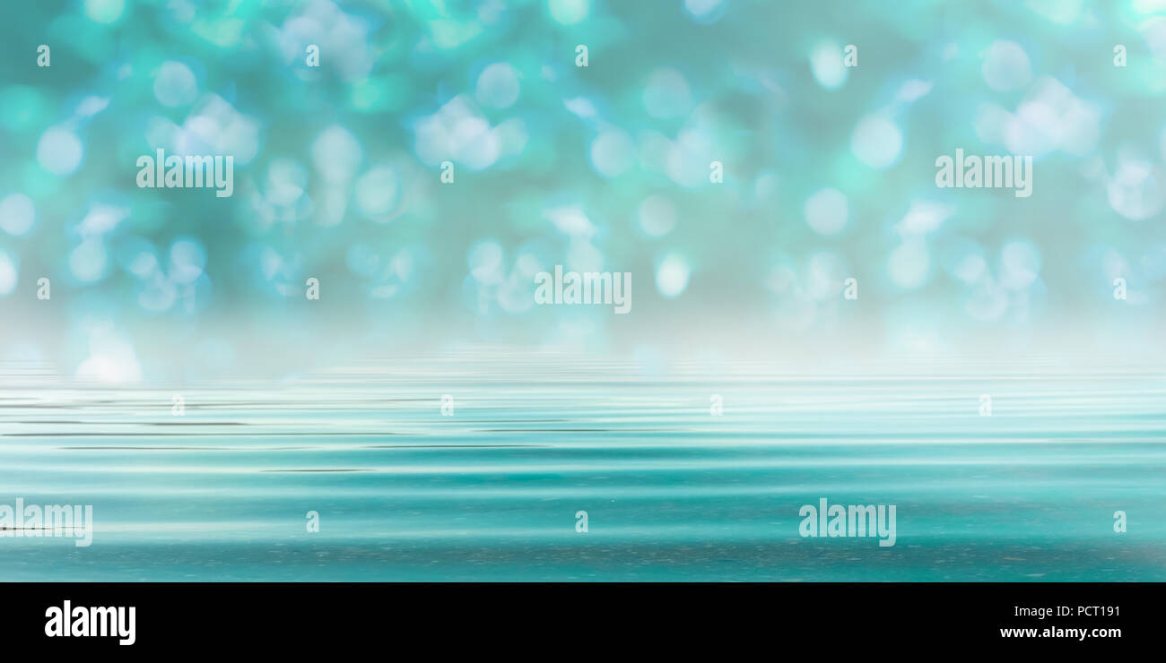 Abstract Blurred Bokeh Forest Background in Turquoise Blue - Spa style with Water Stock Photo