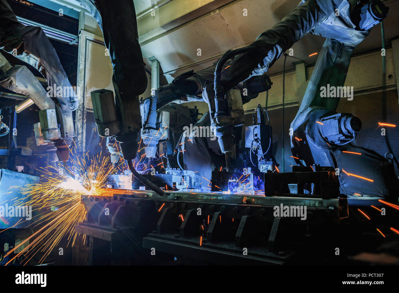 Robot are welding metal part - Stock Image