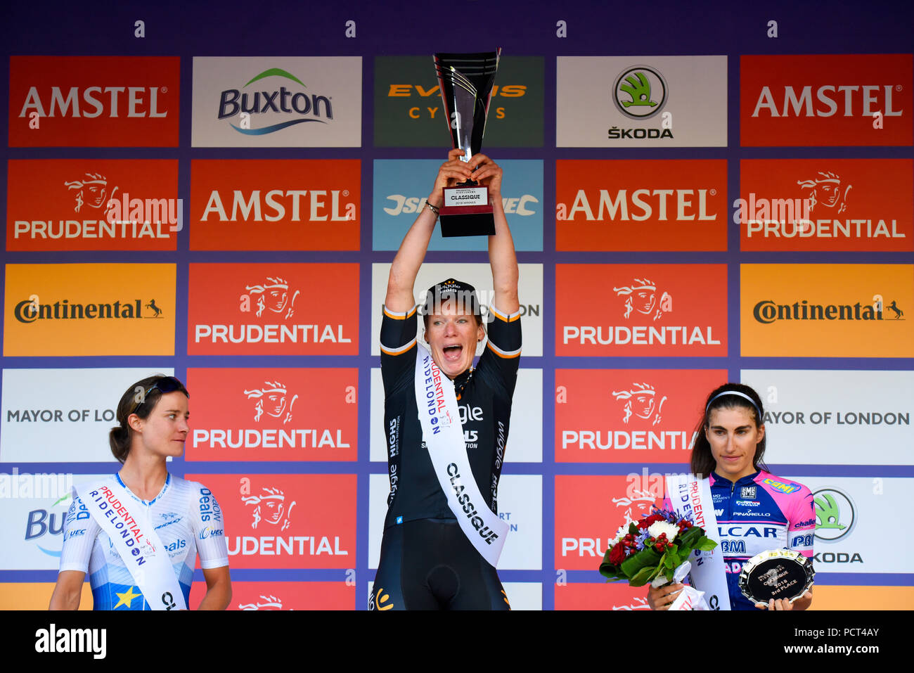 Kirsten Wild, winner, Marianne Vos and Elisa Balsamo celebrating with trophies at Prudential RideLondon Classique women's cycle race. Podium winners Stock Photo