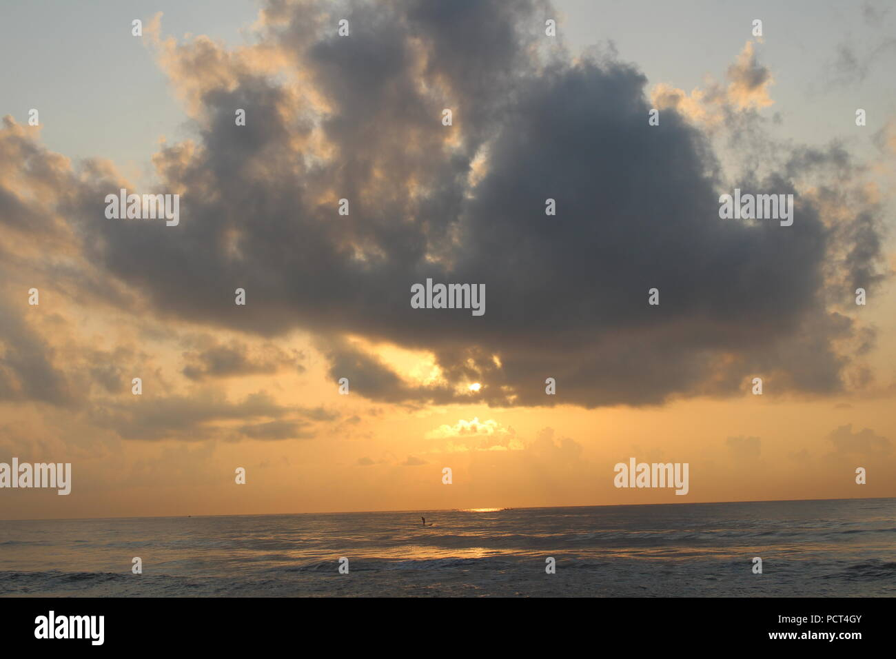 Sun Rise in Clouds - Stock Image