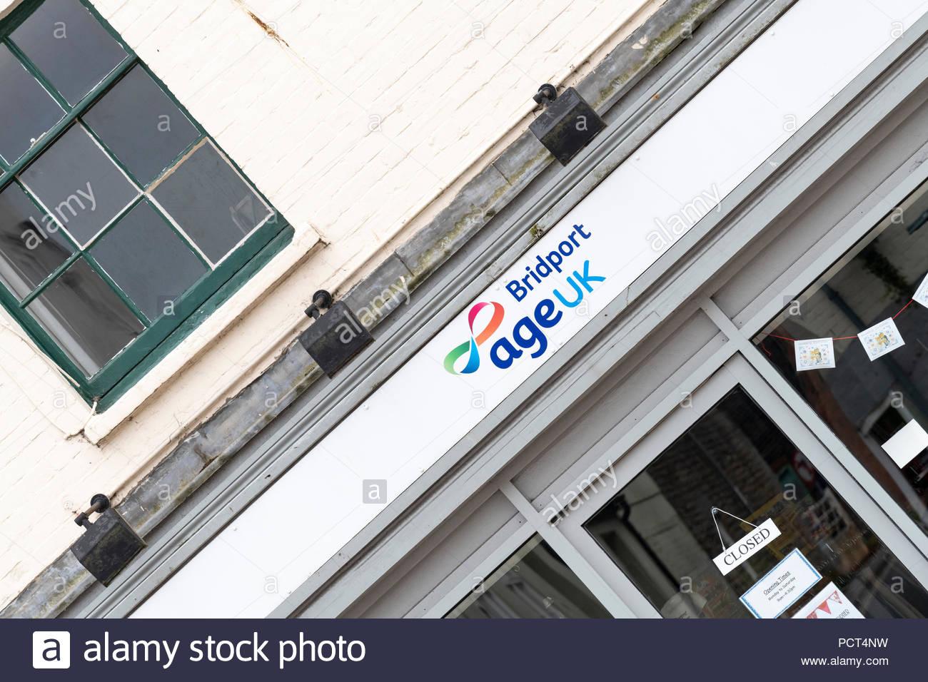 Age UK charity shop, Bridport, Dorset, England, Britain, Europe UK GB - Stock Image