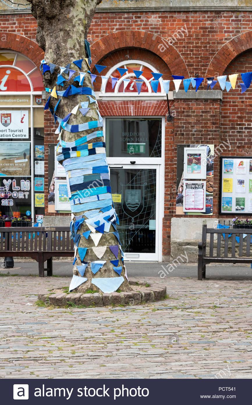 Knitted blue bunting marking Dementia awareness week, Bridport, Dorset, England, Britain, Europe UK GB - Stock Image